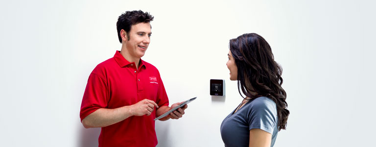 Technician demonstrating how to use home automation
